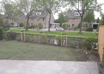 Opgeleverde tuin met een veilig hekwerk